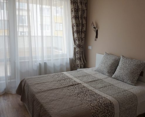 дизайн на спалня в пастелни цветове